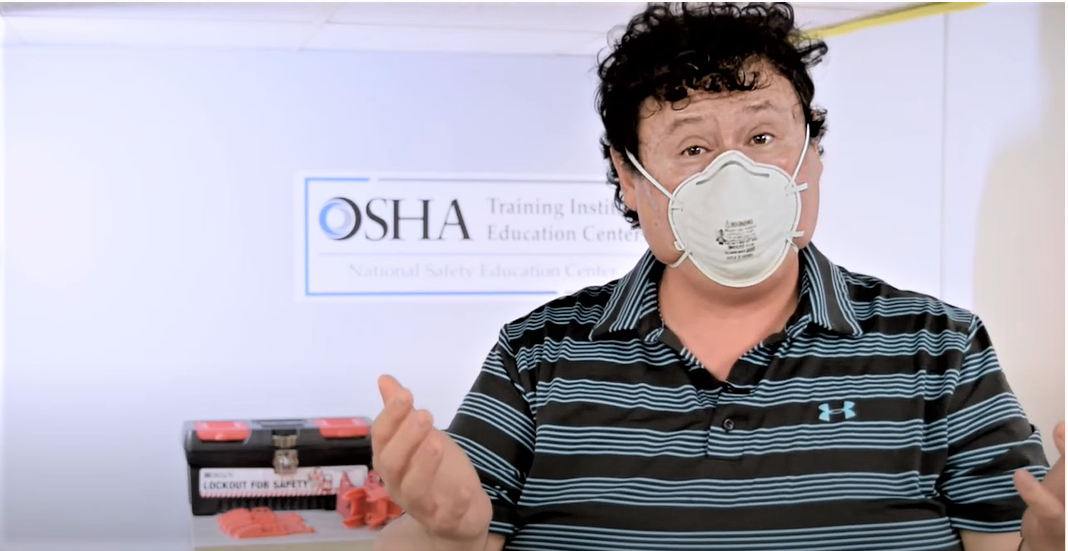 Man showing how to put on a respirator mask